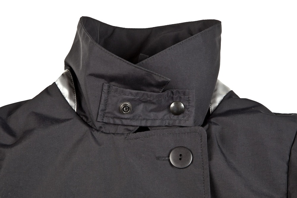 Collar and lapel can be turned up and fastened during extra wet or cold weather.