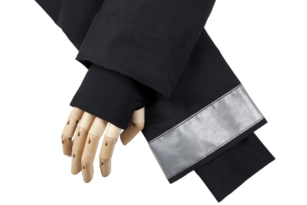 Cuffs turn down to reveal reflective material for hand signaling while riding.  Hand-warmers are sewn in for added coziness. (Please forgive the wood