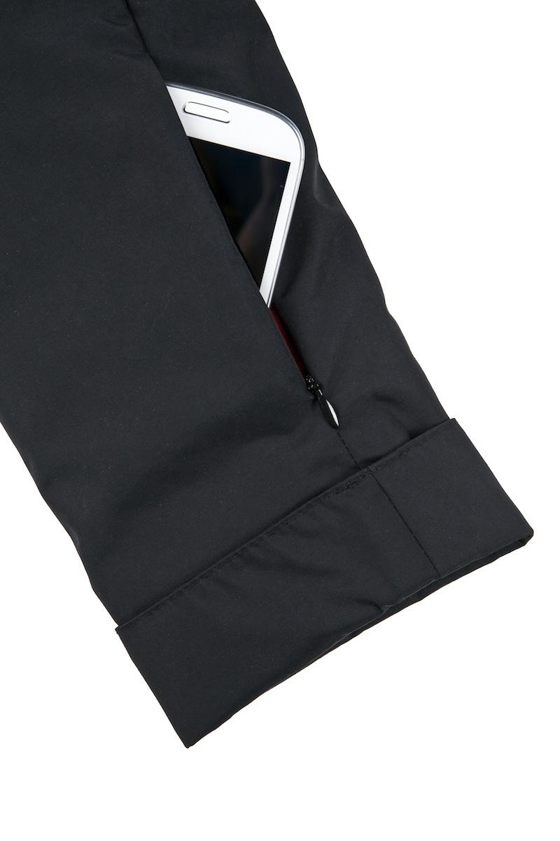 Zippered sleeve pocket carries a cell phone or other essentials.