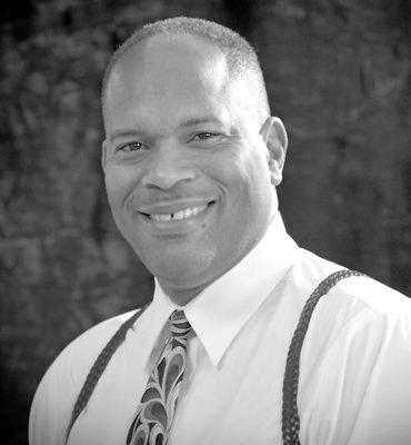 Dr. Carroll G. Odom - Director