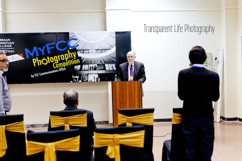 This is the university rector, Dr. Tebbe, welcoming everyone and announcing the students who won the photography contest.