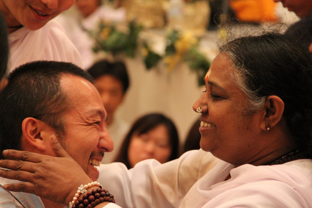 Here is a picture of Koichi (who has since taken the name Viveka) with Amma.