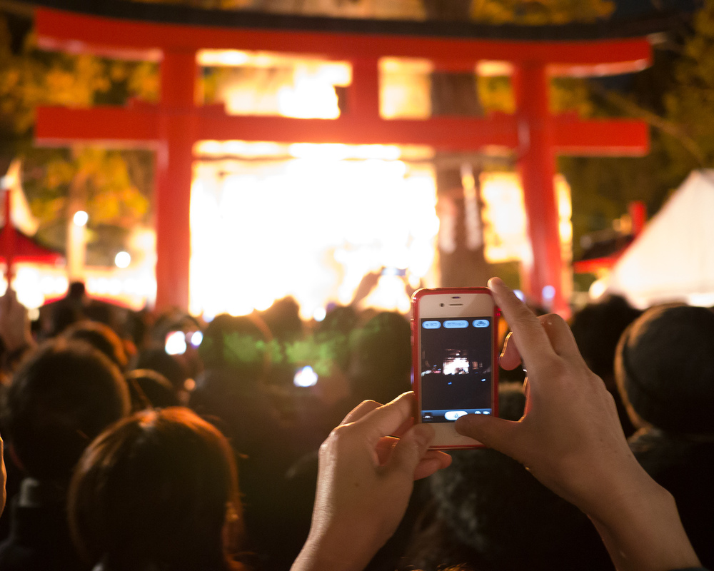 Taking photos at a Shinto fire ceremony in Kyoto.