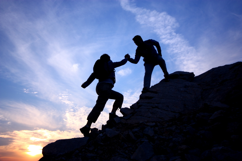 climbing-up-mountain-with-helping-hand.jpg