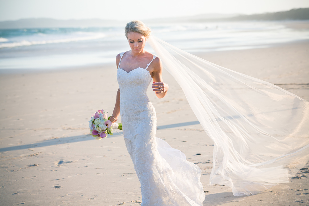 Bride walking on tallows beach byron bay wedding