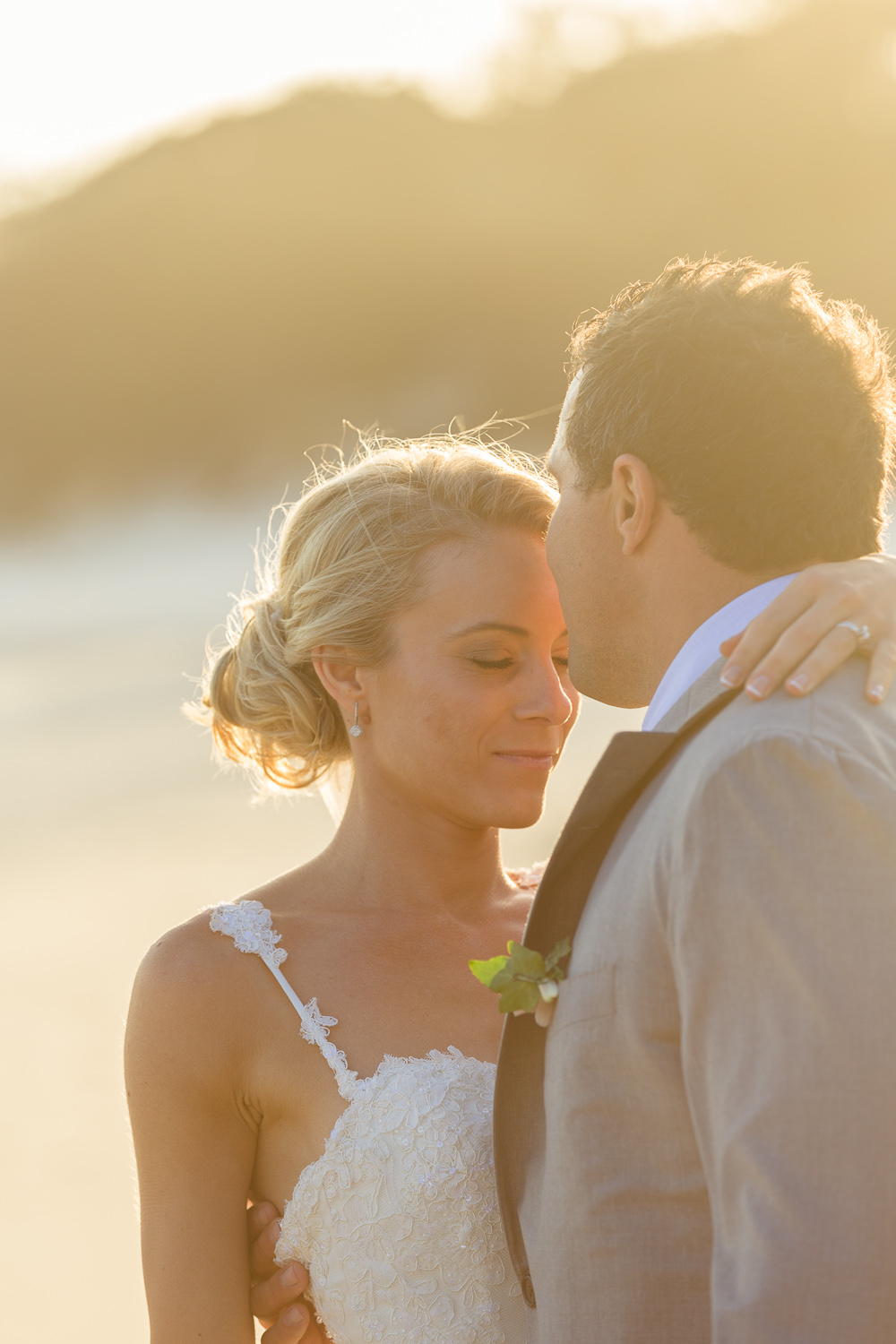 Natasha & Brad embrace on Tallows Beach, Byron Bay