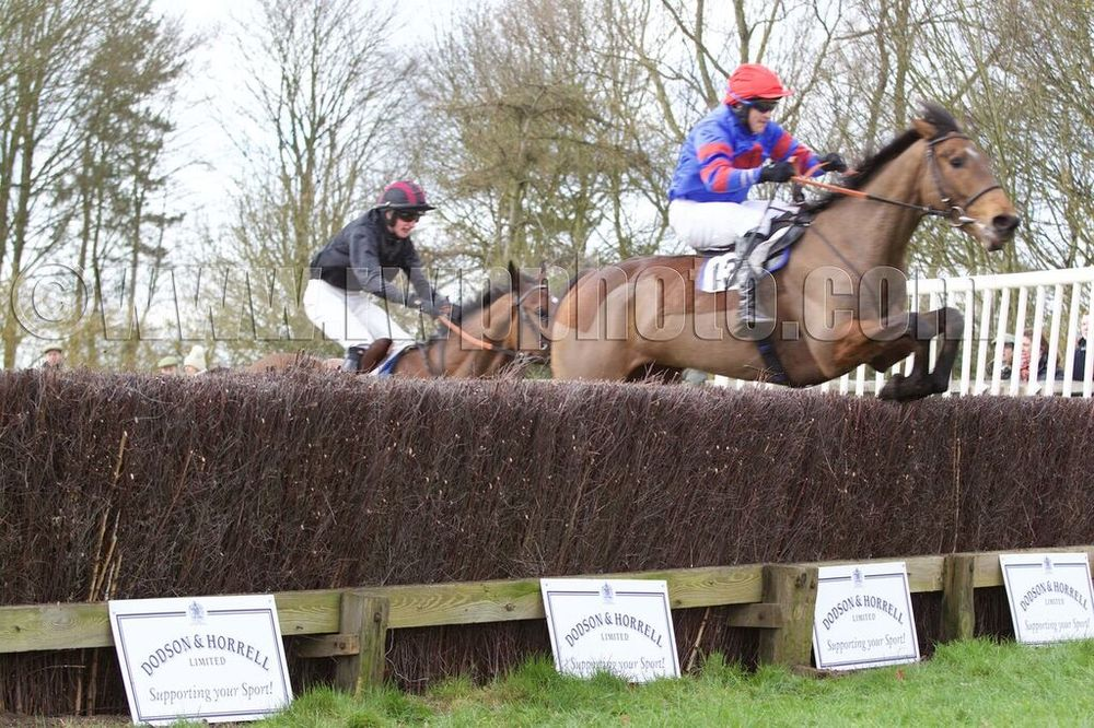 Pedro King (Charlie Dando) has a length to spare over Bengo (Alex Ferguson) at the final fence