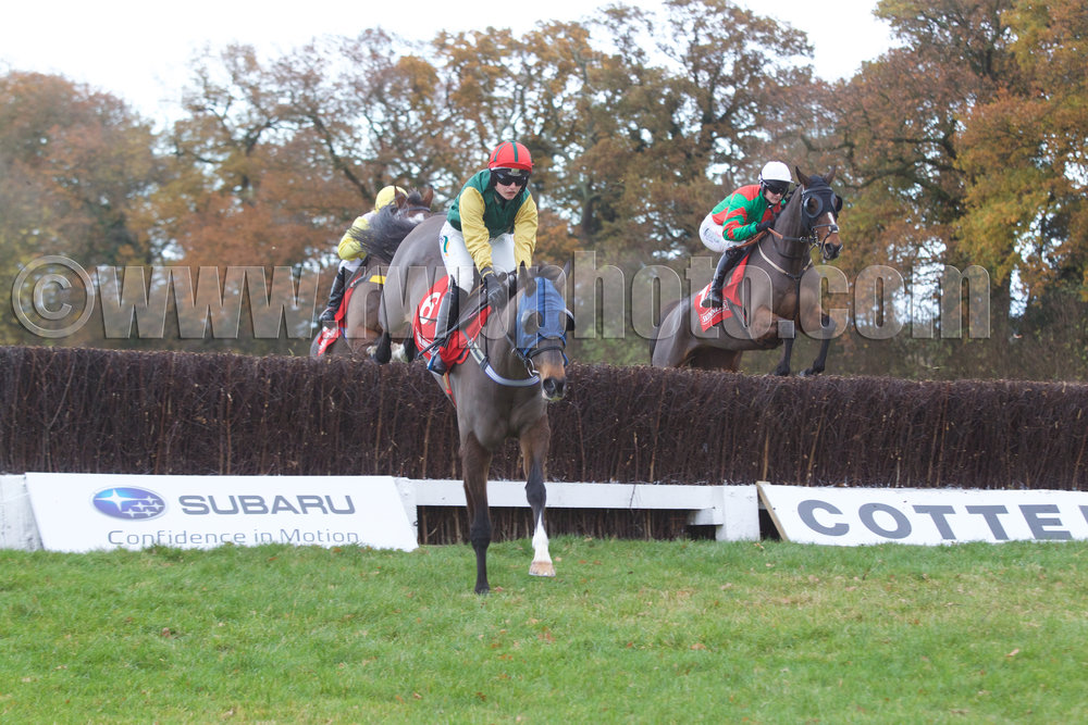 Sharp Suit is in front but Ali Stirling aboard Bound For Glory (right) is waiting to pounce