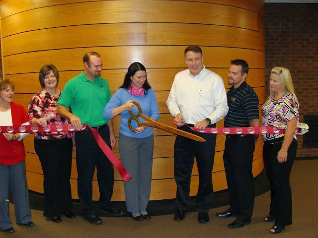 go 2 girl ribbon cutting 2.jpg