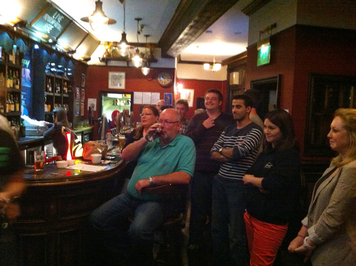 The Colly Quiz crowd watches eagerly as the Dart Off commences.