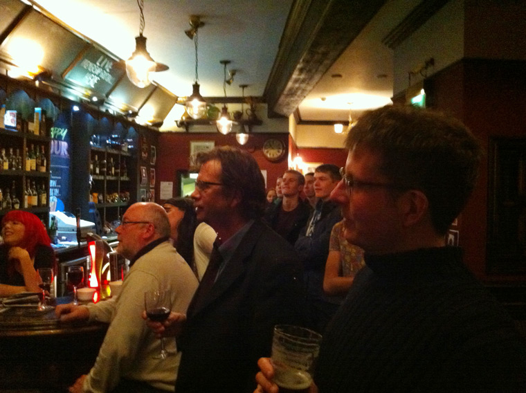 The crowded bar is transfixed.