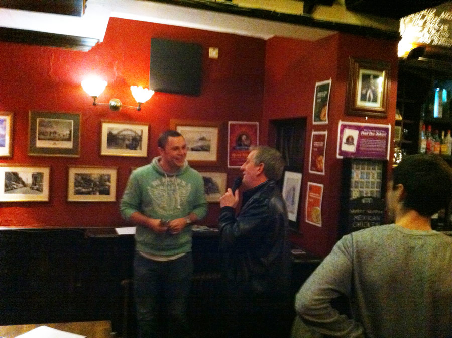 Quiz Master John giving Chris from the Idiots team a bit of coaching.