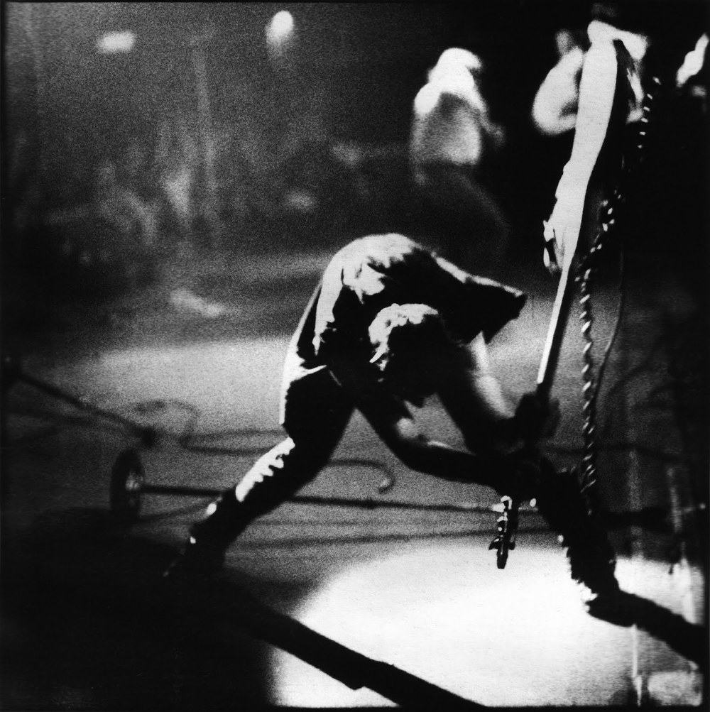 18. The bassist of which punk band is shown about to smash his instrument on the cover of the classic 1980 album London Calling? Paul Simonon of The Clash