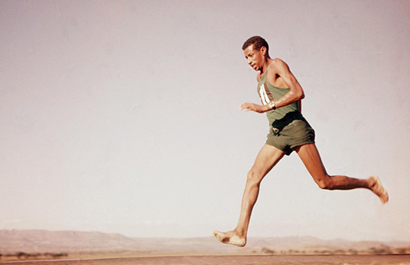 25. What did Abebe Bikila wear when he won the 1964 Olympic Marathon in Tokyo that he didn't wear when he won the 1960 event in Rome? Shoes