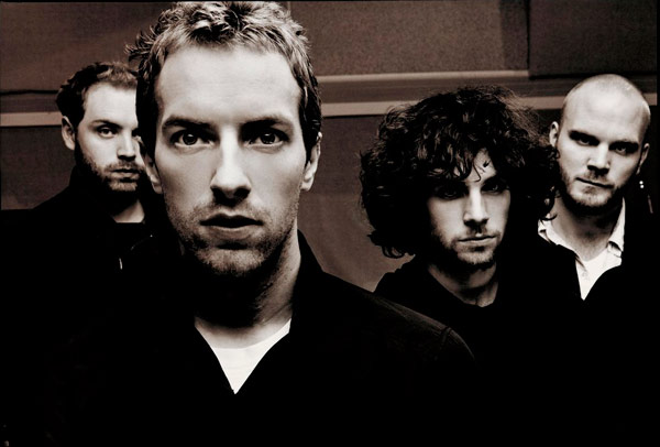 Q16 Come out of things unsaid, Shoot an apple off my head, And a trouble that can't be named, A tiger's waiting to be tamed singing, You are, You are. Name this 2002 hit (by Coldplay)? Clocks (by Coldplay)