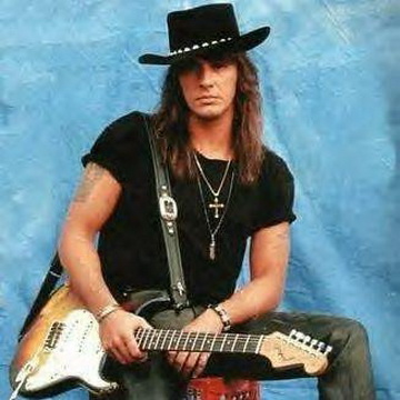 Q14 Richie Sambora plays guitar for which rock group? Bon Jovi