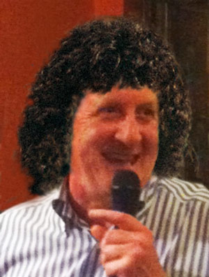 We found an old photo of John with his bubble perm... nice!