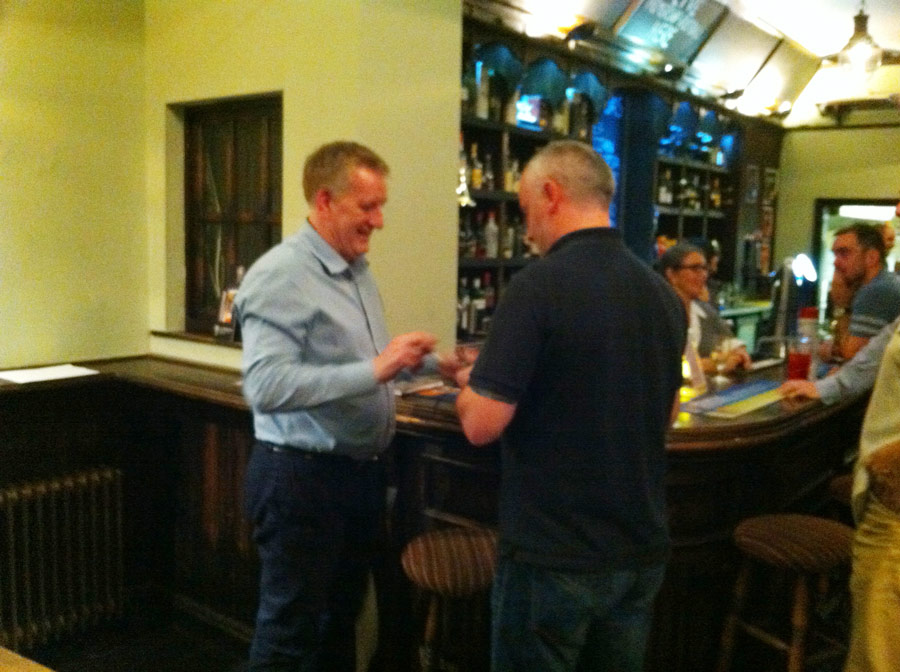 Kenny sizes up the darts.