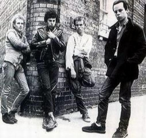 Q19 Which Punk band was fronted by Charlie Harper and had top 40 hits with Stranglehold, Tomorrows Girls, She's Not There and Warhead in late 70's? UK Subs