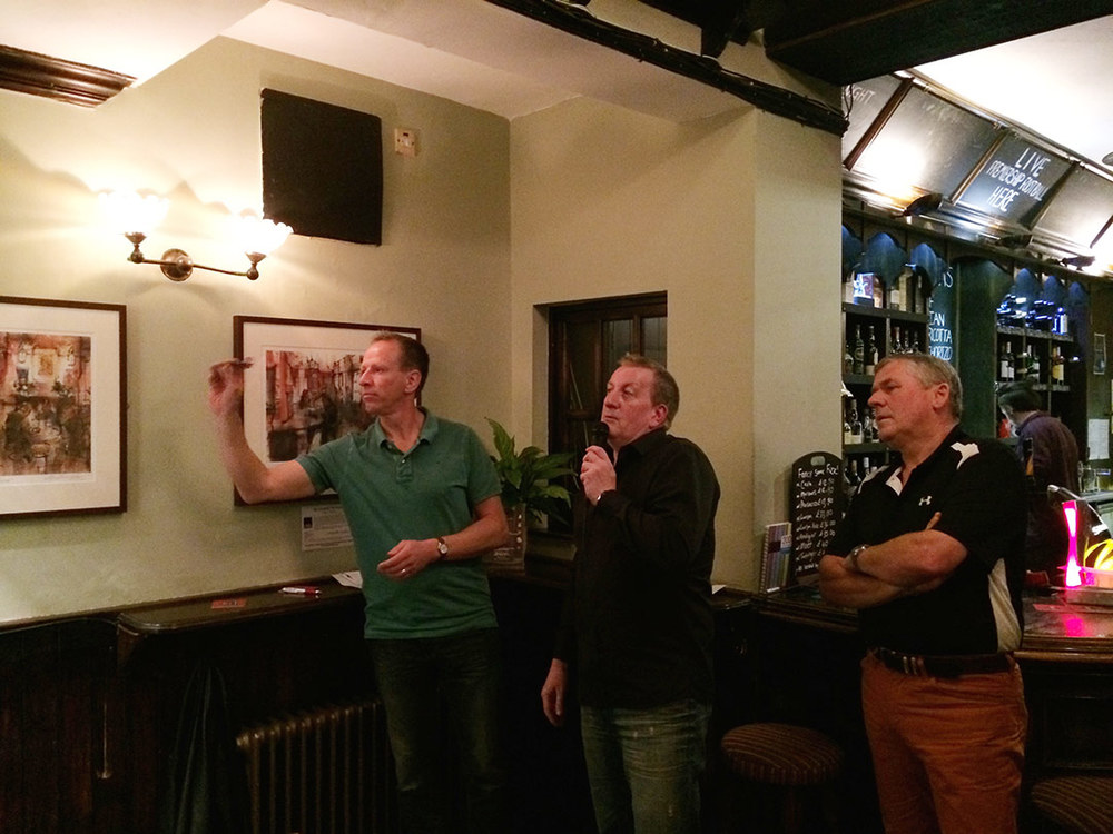 Tom steps up to throw his first set of darts