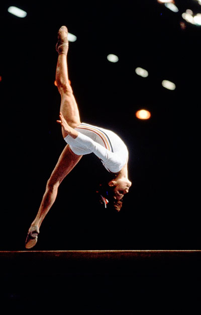 Q30 In the 70s who was the first gymnast to be awarded a perfect 10 at the Olympic games? And for a bonus point... what was the year? Nadia Comaneci, 1976