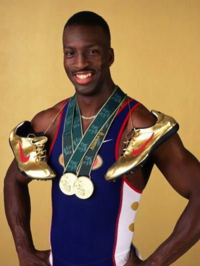 Q25 Which track athlete broke both the 200 and 400 meter Olympic Records (in gold running shoes) at the 1996 Olympics? Michael Johnson