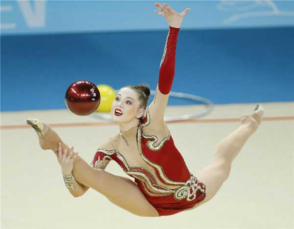 Q22 In what individual Olympic event can a competitor use a rope, hoop, ball, clubs or ribbon? Rhythmic Gymnastics
