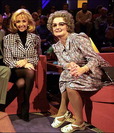 """Q36 In 1995 which chat show host's first question to Debbi McGee, the wife of TV magician Paul Daniels was """"So what first attracted you to the millionaire Paul Daniels?"""" Mrs Merton played by comedienne Caroline Aherne"""