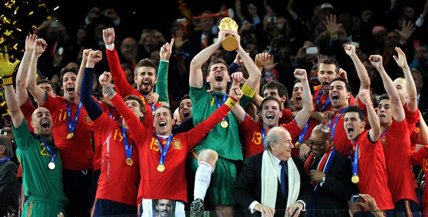 Q21 Who were the first European team to win football's World Cup where the tournament was played outside of Europe? And for a bonus point where was this tournament held? Spain in 2010 when the World Cup was held in South Africa