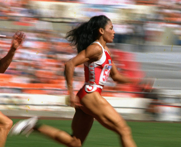 Q28 Still considered the fastest woman of all time, which American won three gold medals at the 1988 Olympics, including setting World Records for the 100 and 200 meters? Flo Jo (Florence Griffith Joyner)