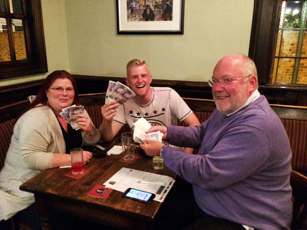 Quiz Winners  Shaken Not Stirred  (Sarah, Hodgie and Richard) flash their £181 Cash Prize