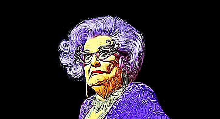 Dame-Edna-Slip-Avoids-Dart-Off.jpg