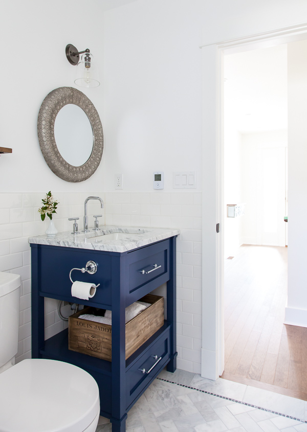 white + navy bathroom: thehousediaries.com