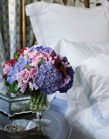 Cluster of scented vintage blooms are relaxing for this bedside table in the guest bedroom.