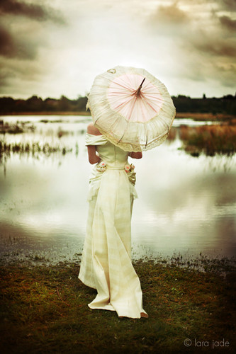 The worn colors of a vintage umbrella can tell a story of every kiss and encounter of rains that so long ago passed.