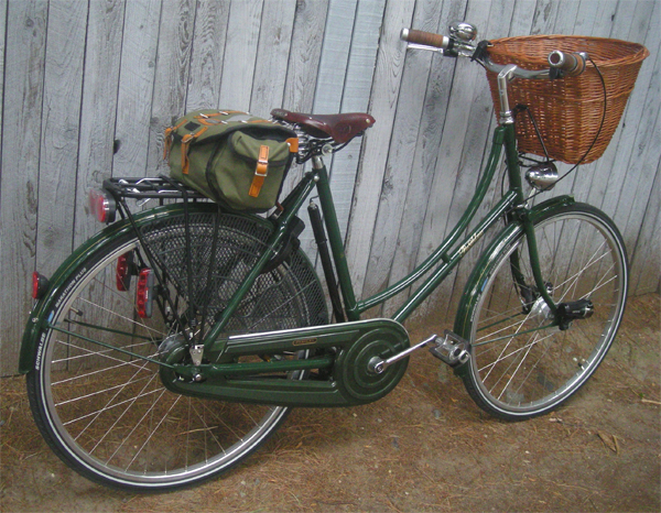 Pashley Princess woman's bicycle in green with brown wicker basket at the handlebars.
