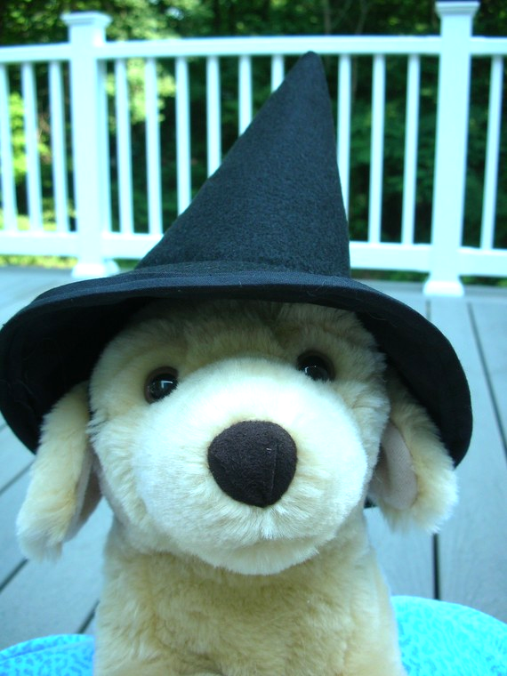 Classic witch hat for any size dog, held in place with comfy elastic chin strap. You can't do better than this for a classic Halloween look for any size dog.  These are custom sized for small, medium and large canines and have a comfy elastic strap to keep them on.