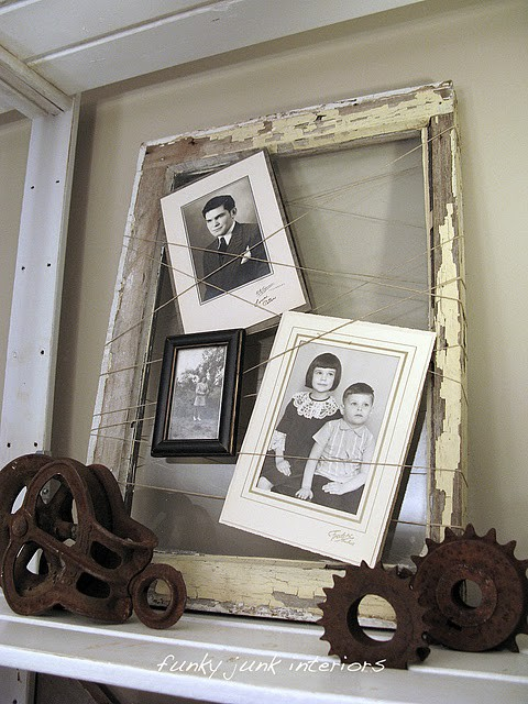 Creating a  spiderweb backdrop for old photos  (unframed in this case works best because of the weight) is a perfect idea and allows for a few smaller photos to make a larger statement.