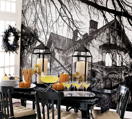 Spooky black and white murals (like this one from Pottery Barn) or wallpaper as your main Halloween decor for a room can be a far out use of a photograph.