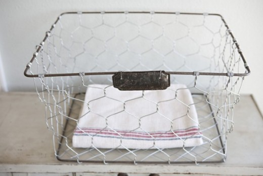 vintage wire basket perfect for linens and towels.jpg