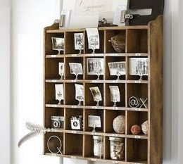vintage cubbies for storing old photos cameras knick knacks.jpg