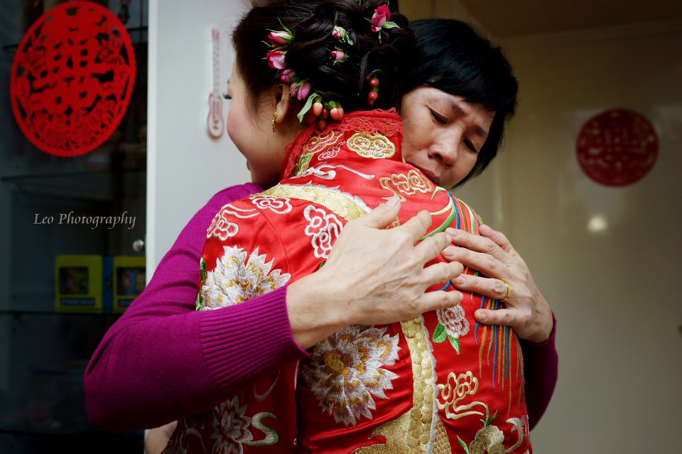 The poignant look of a mother hugging her daughter on  her wedding day.  Photographer:  Chi Kin Lai - Leo Photography (Hong Kong)