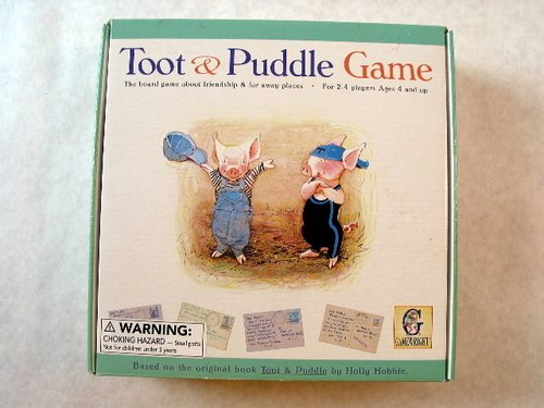 CLICK TO BUY Toot and Puddle Game: The board game about friendship and faraway places, with dice, postcards, game board, etc.