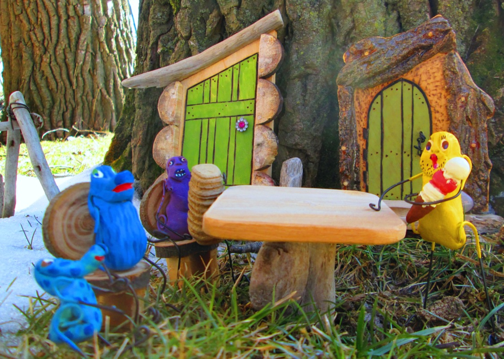 One of a kind mystical magical miniature fantasy world art pieces by C.S. Alexis of Adrift Art Studio.  Shown here: Miniature Fairy Garden Furnishings (garden fairy doors, swing, table and chairs)  and Wee Bees the Peops.  Each crafted to endure outdoor fairy garden weather year round. AVAILABLE AT: WALK SOFTLY 13 on Etsy.