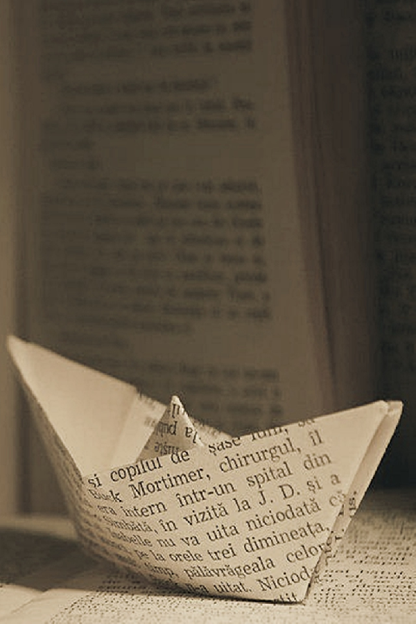 paper boat out of book pages