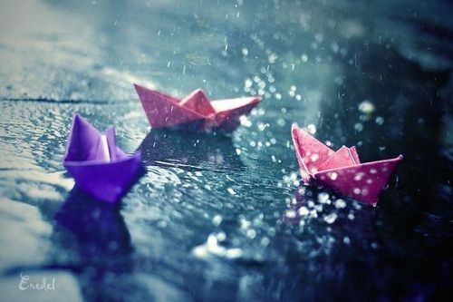 floating paper boats in the rain