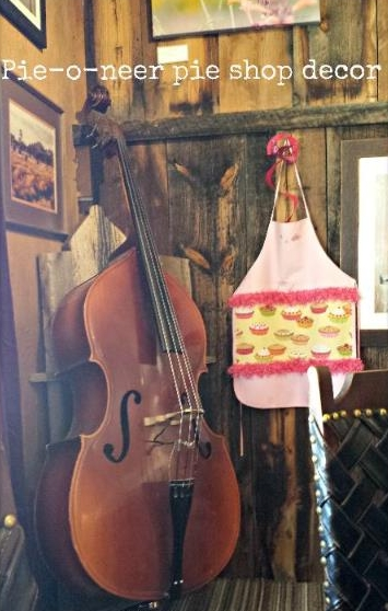 Corner of the Pie shop in pie town, New Mexico. The bass played on music nights is stored here. And one of the pie aprons hangs on the wall.