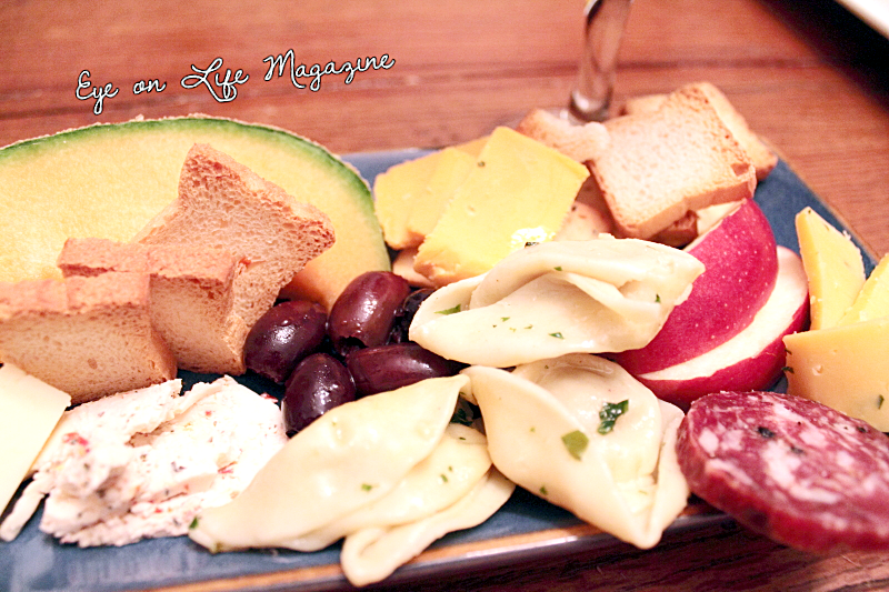 Friday Night's Sampler Platter with Good Friends and Family Calamata olives, pasta, sausage, fruits, cheeses, toasties. Food Photography by Michelle PG Richardson for Eye on Life Magazine.