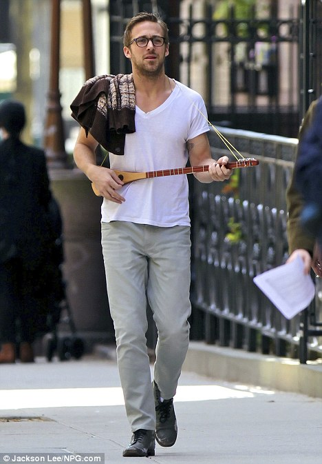 And still be incredibly sexy walking down the street playing a dainty-little-banjo-thing.