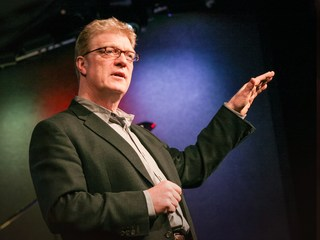 Ken Robinson, striking the traditional TED Talk Pose.